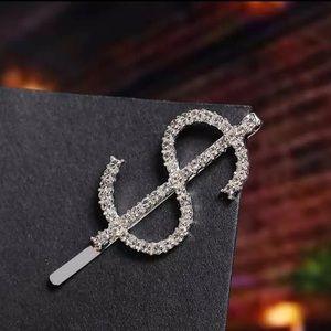 Dollar sign crystal hair pin